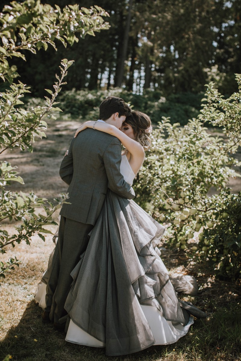 Newlyweds kissing on forest path at Sea Cider Vancouver Island