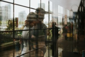 Engaged Couple Reflection through panes of glass