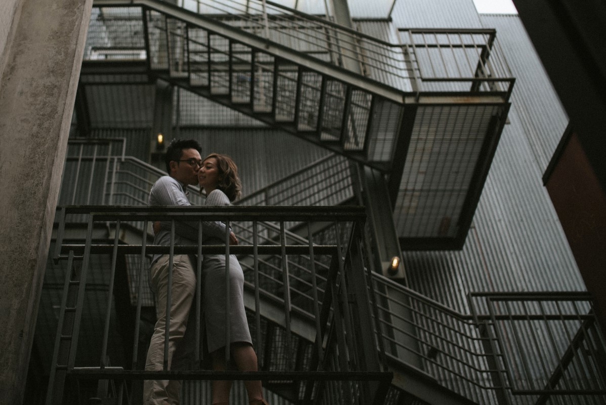 Vancouver couple share a kiss on the fire escape