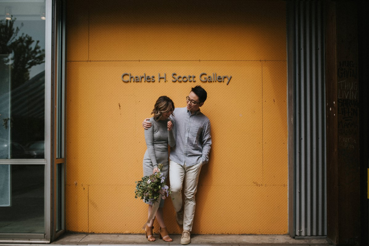 Vancouver Couple pose in front of Charles H Scott Gallery