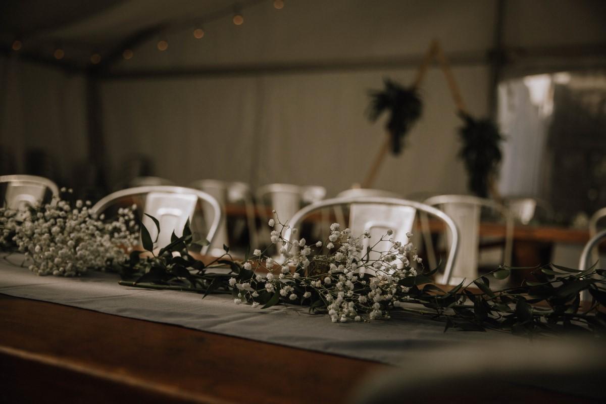 Babys Breath Gypsophila and Italian Ruscus on Wood Tables Wedding Reception Vancouver Island