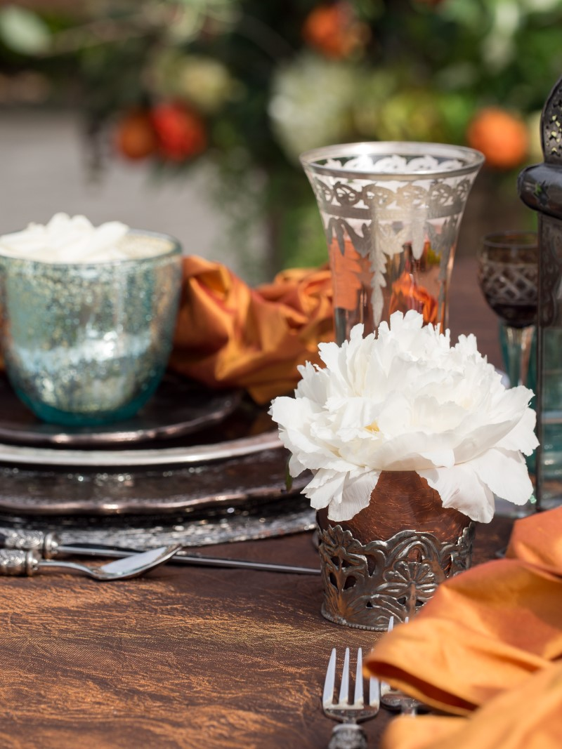 White Peony with Burnt Orange and Pewter Dishes at Poet's Cove Resort & Spa