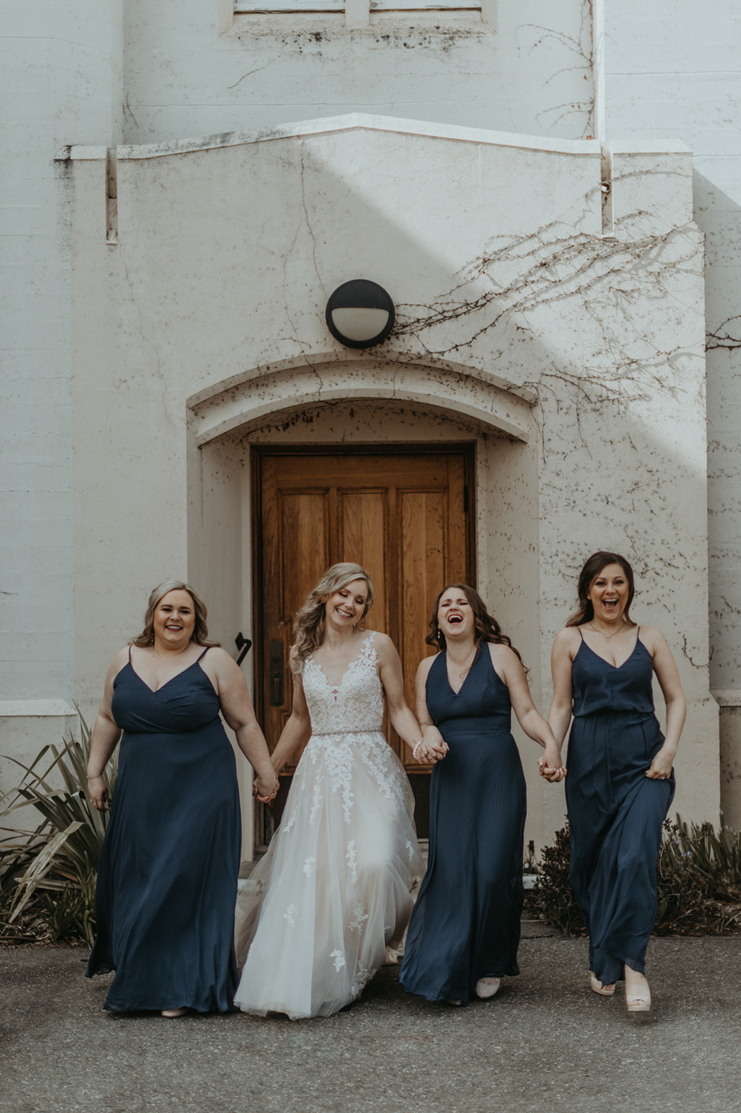Bride and her bridesmaids wear gowns by Blush Victoria on Vancouver Island