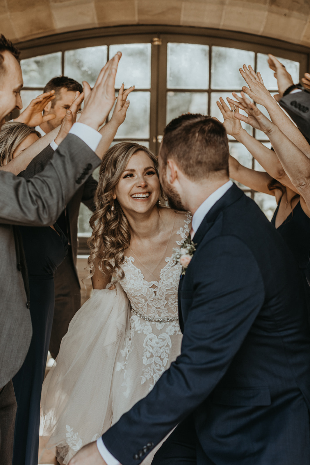Bride with Makeup by Alexa smiles at groom as friends applaud on Vancouver Island