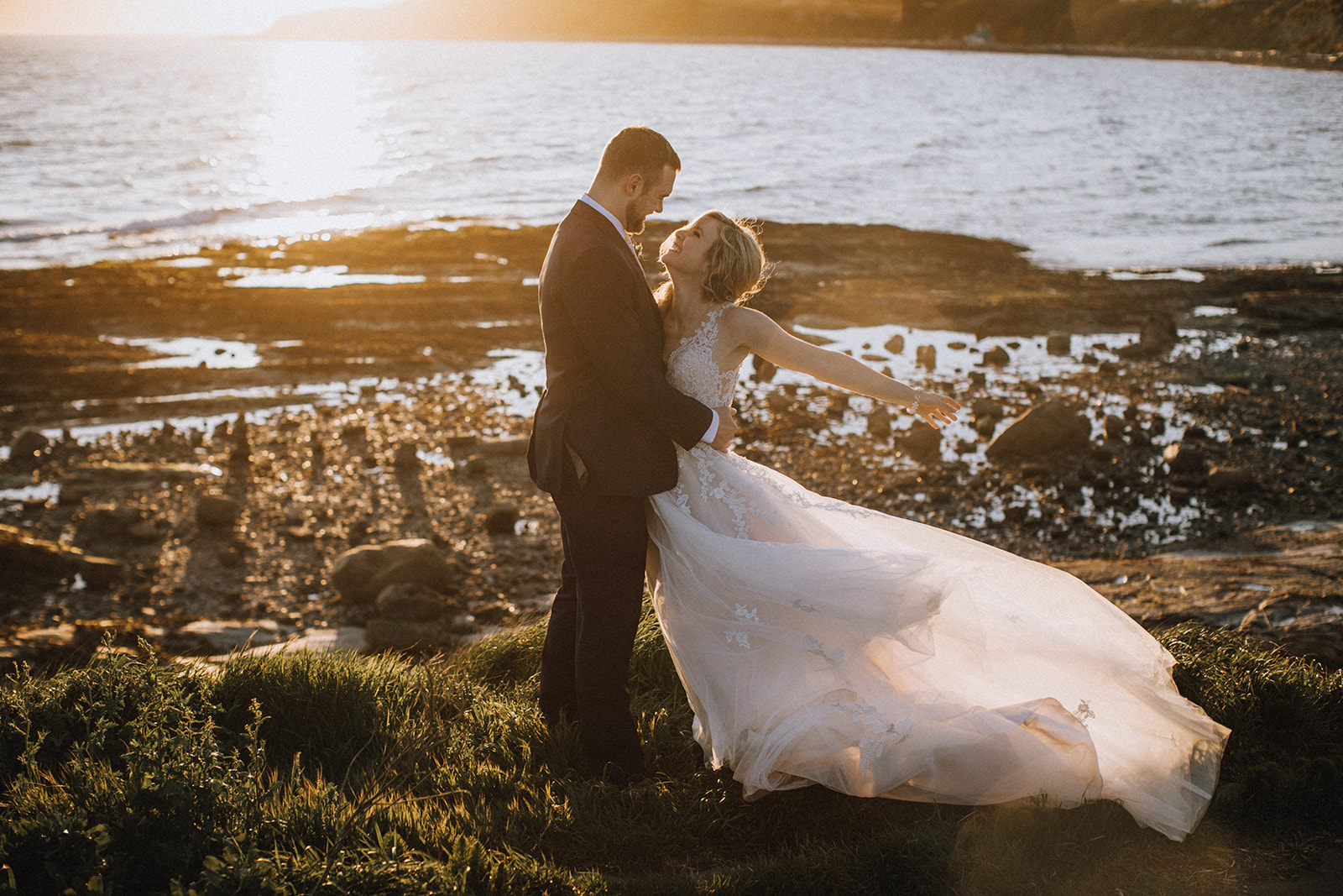 Newlyweds on the beach at sunset on Vancouver Island by Secret Waters Photography