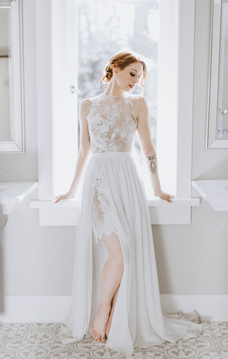 Sophisticated Bride in flowing lace gown sitting on windowsill at Maple Bay Manor