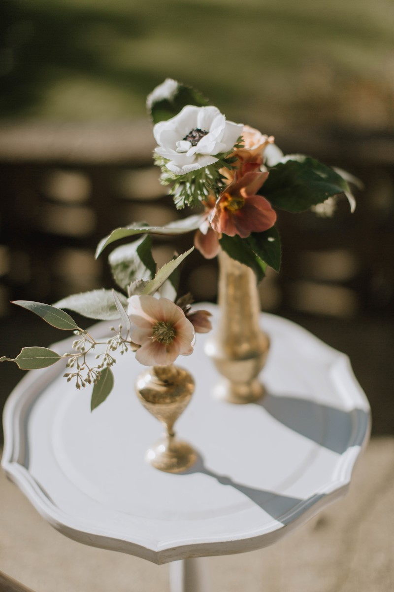 Floral in gold candlesticks by Myrtle and Moss Photography