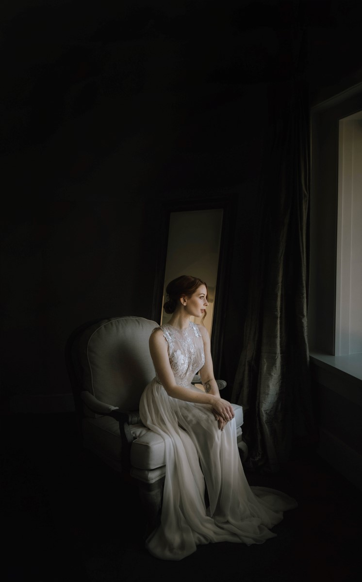 Sophisticated Bridal Portrait in front of window West Coast Weddings Magazine