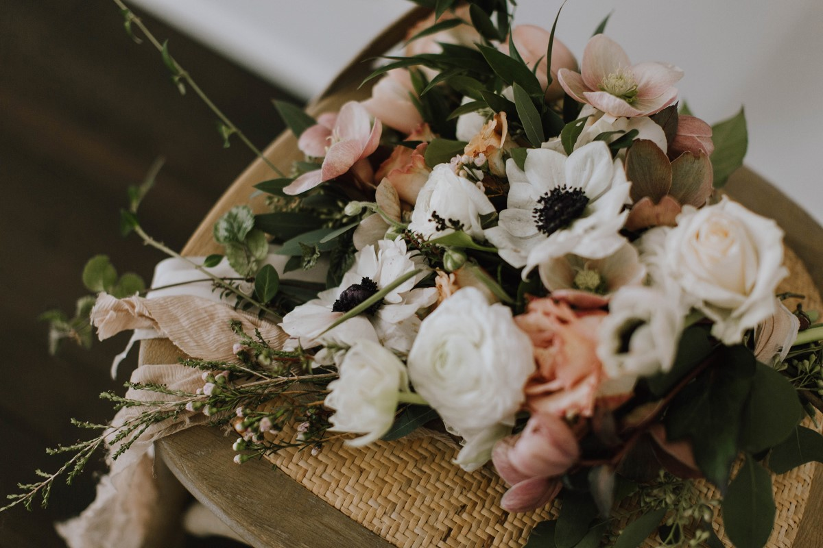 Sophisticated Wedding Bouquet of anemones and peach roses Myrtle and Moss Photography