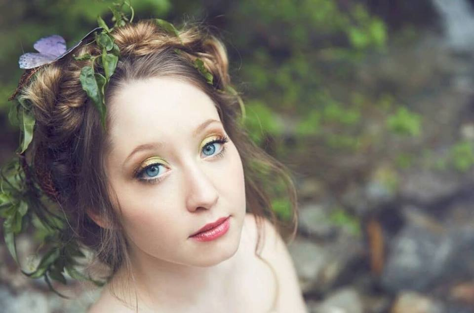 Whimsical Woodland Bride with ferns and butterfly in her braided hair