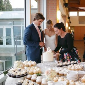 Choosing Wedding Professional Emma McCormack helps newlyweds cut cake