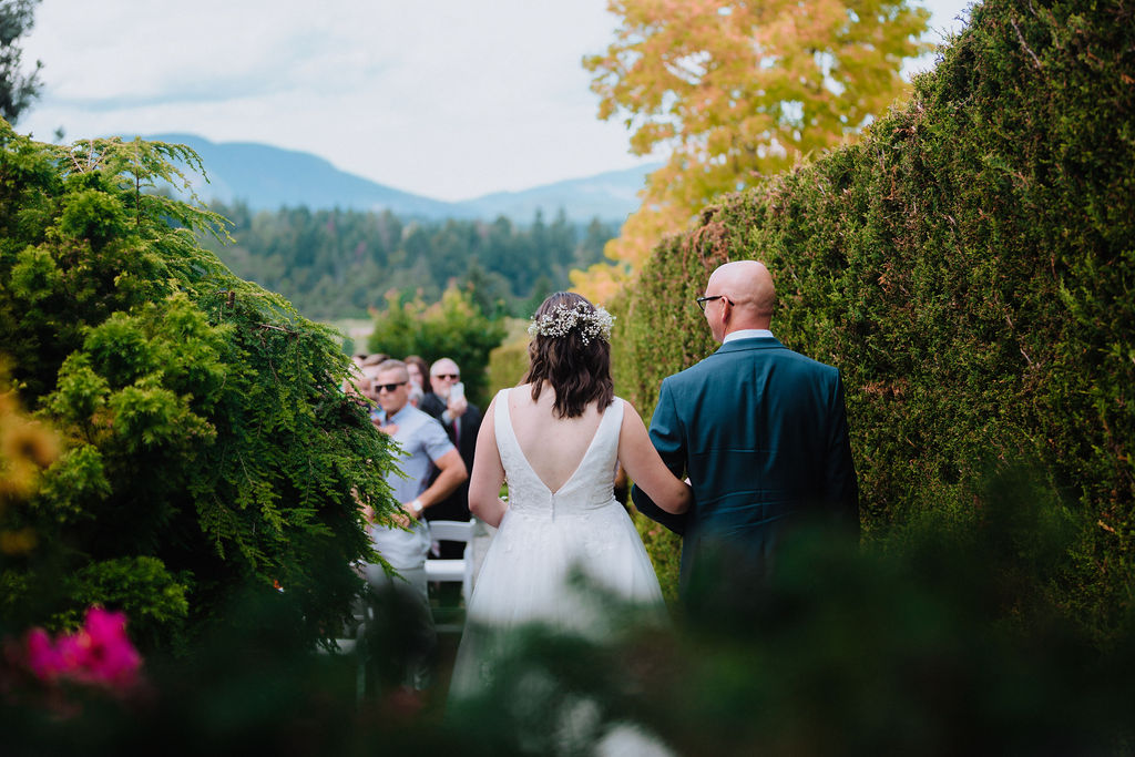 Bride and father walk to ceremony at Arbutus Ridge Golf Club by Megan Maundrell Photography