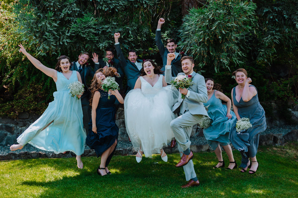 Newlyweds and wedding party celebrate at Arbutus Ridge Golf Course