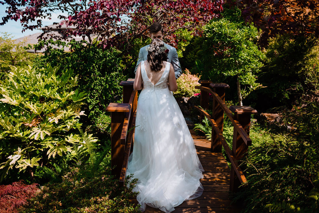 Sun dappled newlyweds walk through Arbutus Ridge Golf Course gardens on Vancouver Island