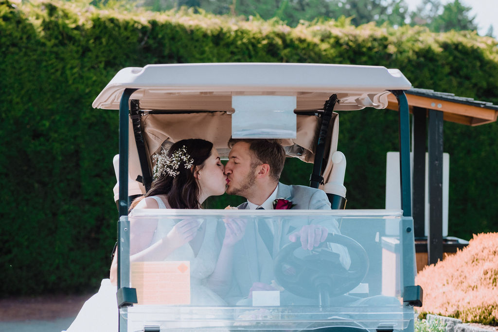 Newlyweds ride the golf cart at Arbutus Ridge on Vancouver Island
