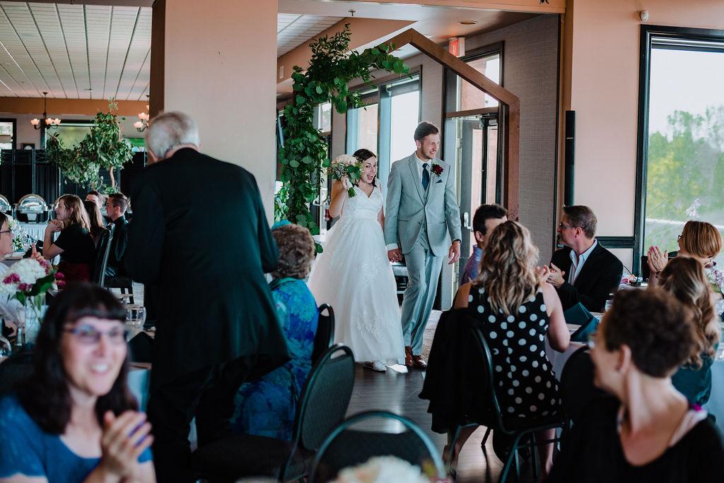 Newlyweds enter reception at Arbutus Ridge Golf Course