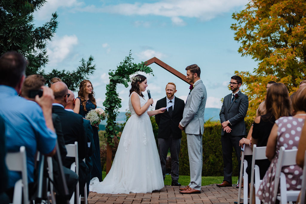 Newlywed Couple exchange rings at ceremony overlooking ocean on Vancouver Island