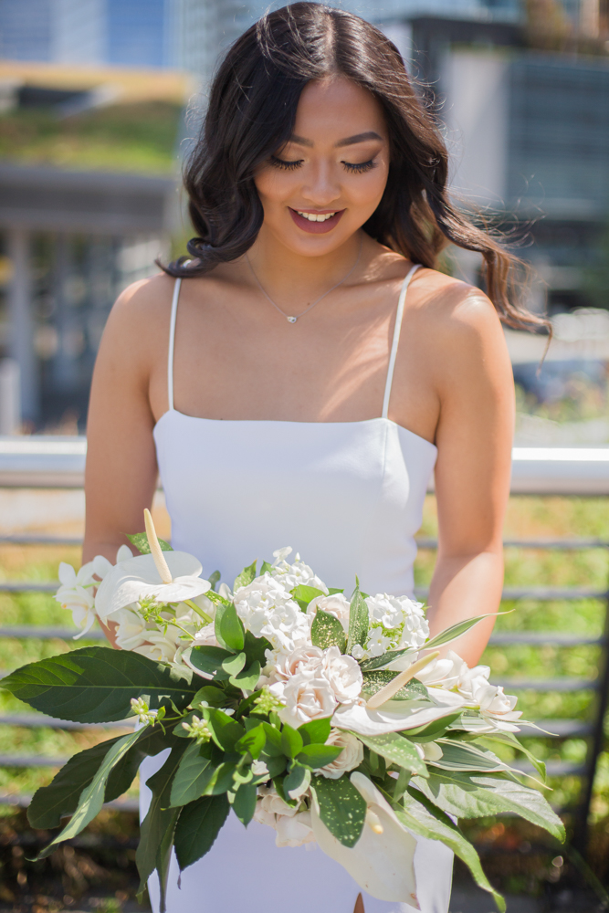 City Chic Bride and bouquet of white lilies