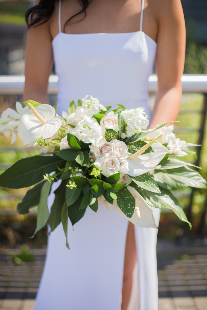 Bridal bouquet with white lilies and greenery