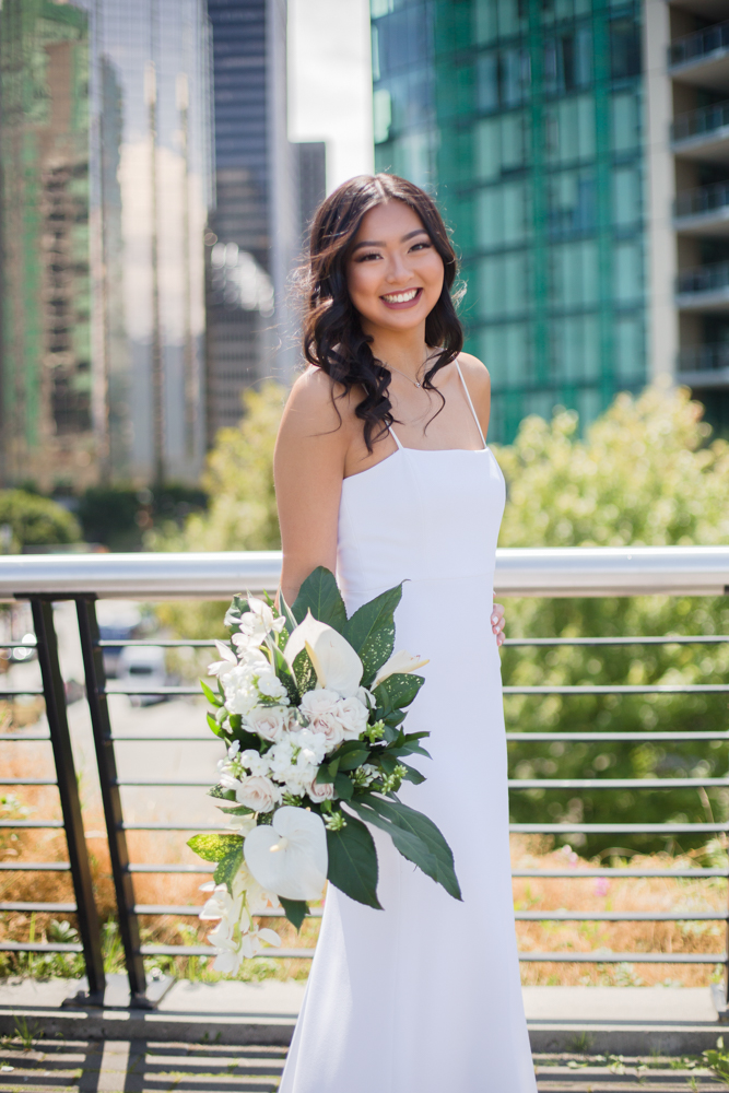 Vancouver bride holds Karen Wazny bouquet of white lilies