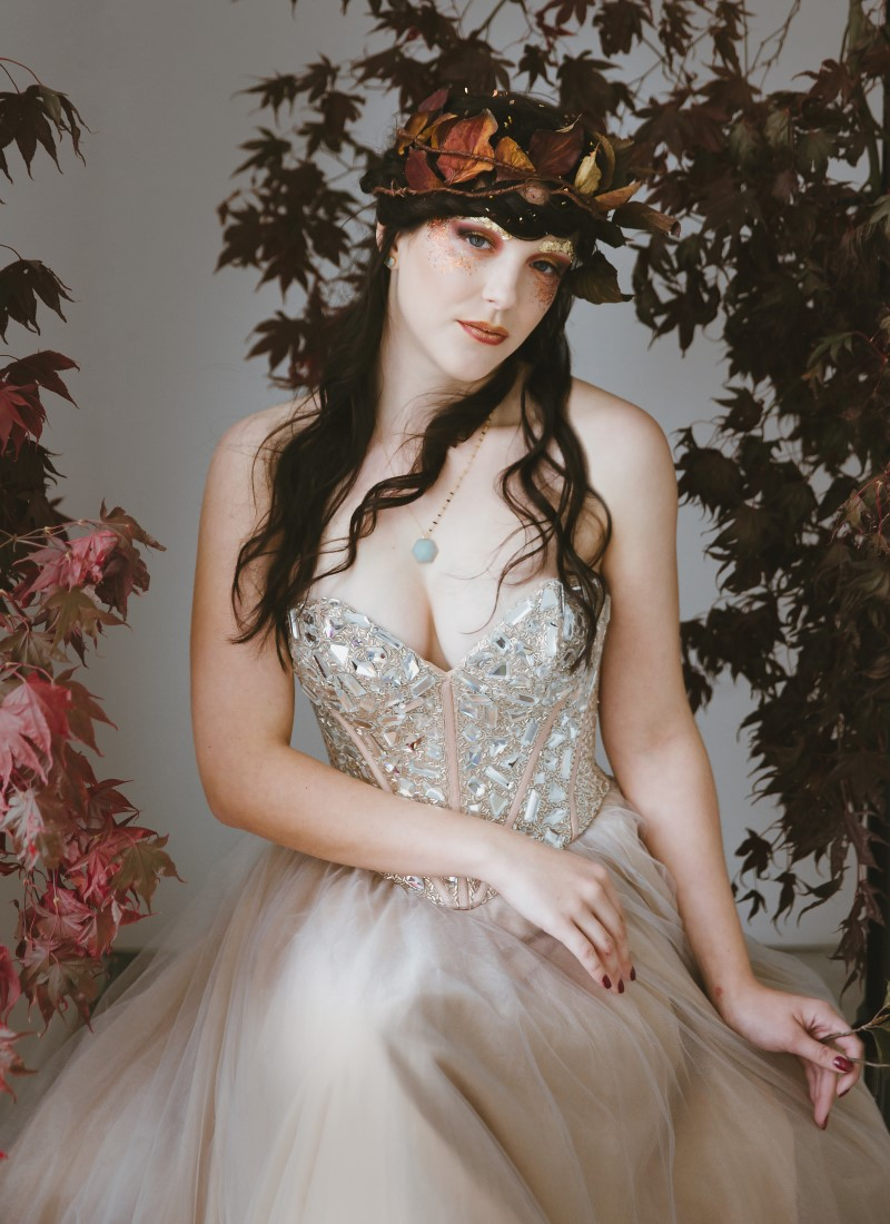 White Wedding Gown on bride with Royal Decor