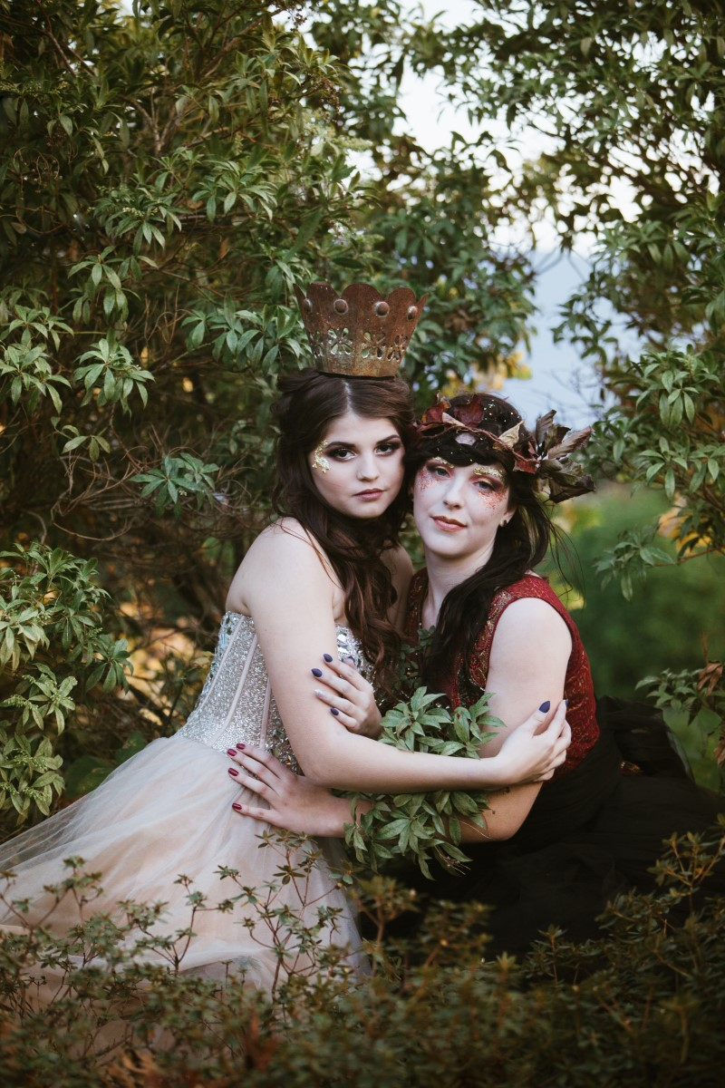 Two brides in royal styled gowns