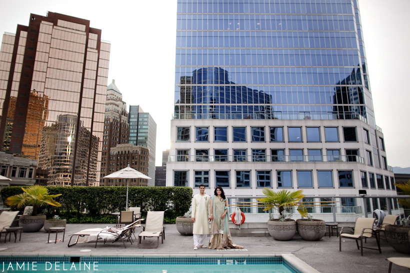 Wedding Couple standing in front of the Vancouver Fairmont Waterfront