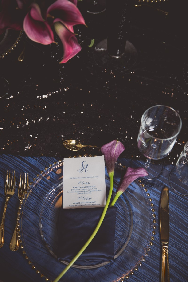 Sophisticated Table Setting by Paradise Events in Vancouver with burgandy calla lily and glass charger plate