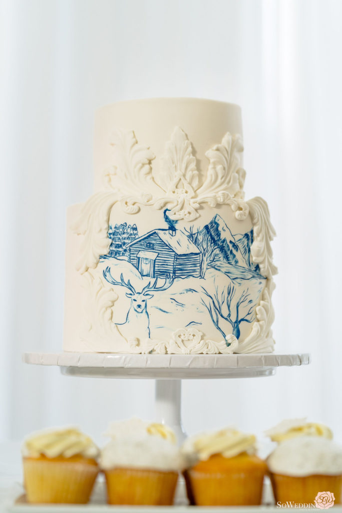 Winter Magic Wedding Cake with blue painting by So Wedding Photography