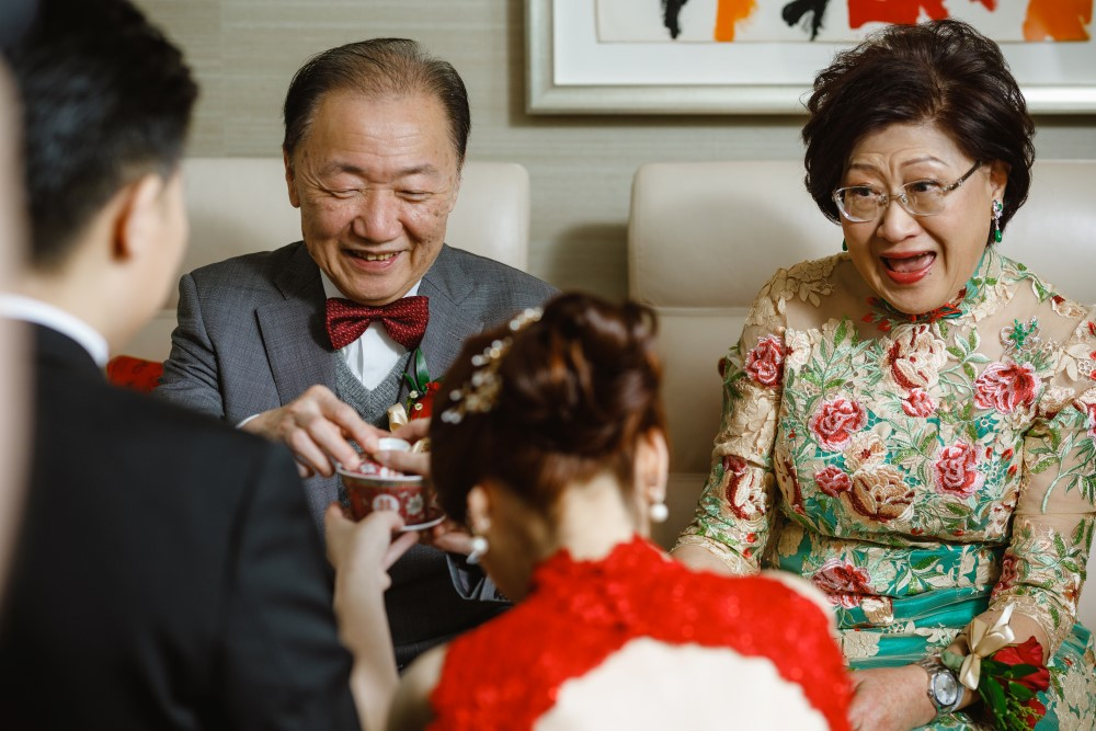 Couple bow before grandparents in traditional tea ceremony in Vancouver