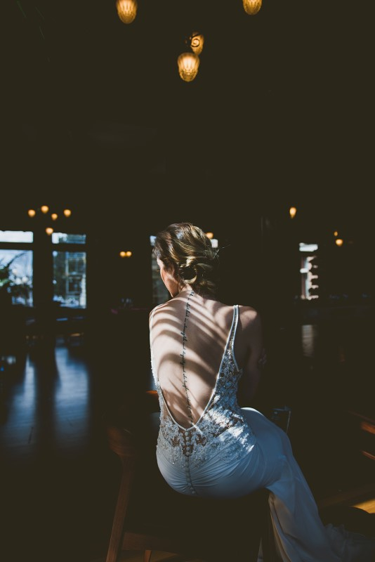 Tropical Empress Wedding bride with hair by Hunt and Gather in dappled sunlight on Vancouver Island