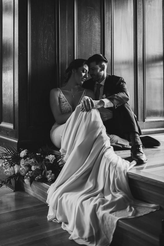 Newlyweds in window seat at Fairmont Empress for West Coast Weddings Magazine