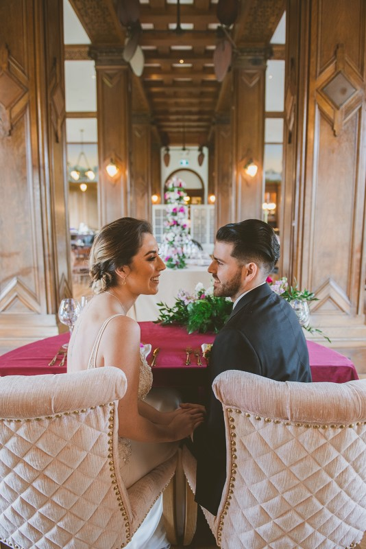 Newlyweds at sweetheart table by Sublime Celebrations in Bengel Lounge Vancouver Island