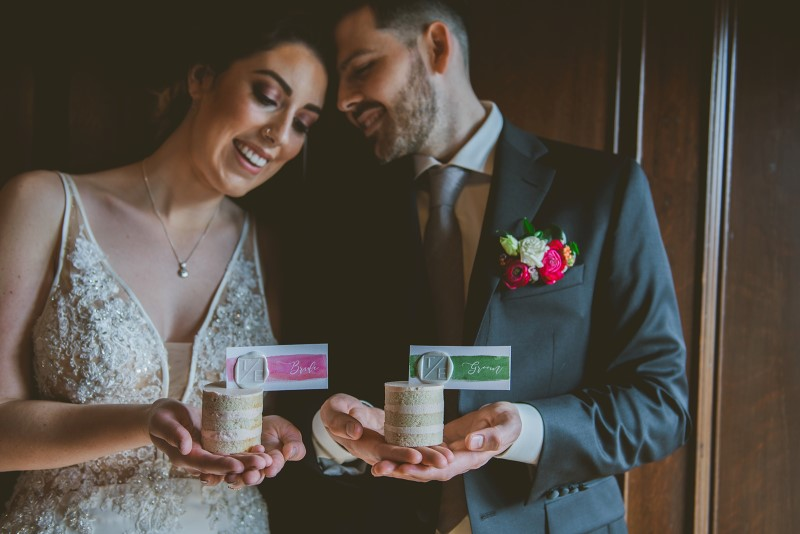 Newlyweds holding individual wedding cakes by Allison Shelrud on Vancouver Island