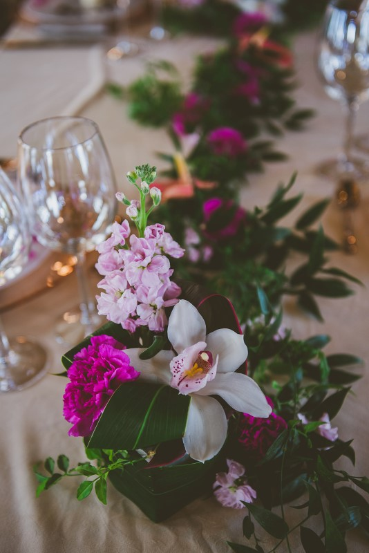 White orchid on sweetheart table at Fairmont Empress by Brown's the Florist