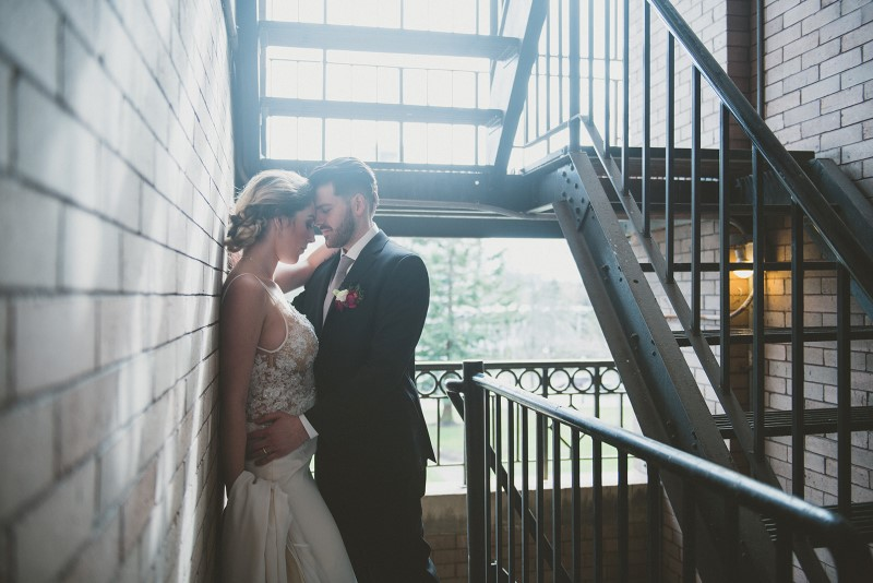 Couple in stairwell Shades of White Bridal on Vancouver Island