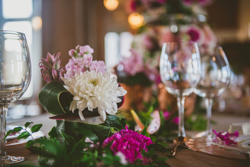 Crystal Glasses reflect Fairmont Empress reception table of tropical flowers by Brown's the Florist
