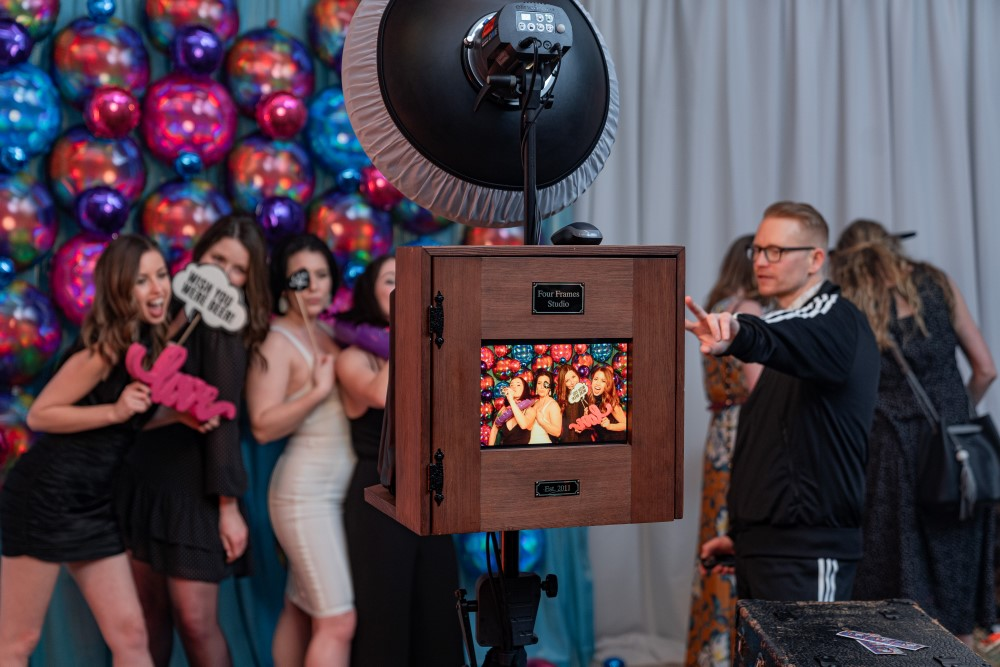 Four Frames Photo Booth takes photos in front of balloons at Vancouver Island Wedding Awards 2020