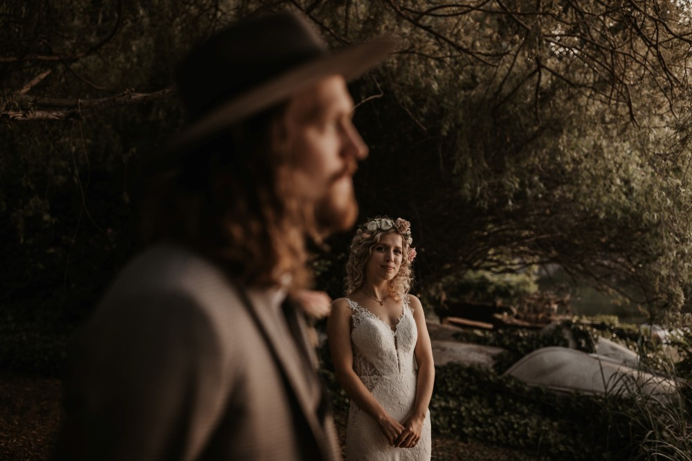 Golden Hour Sunshine Coast elopement focus on bride wearing Martina Liana Gown at Bisou bridal groom blurry out of focus staring off