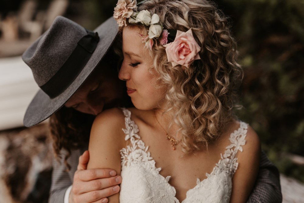 Bride in Martina Liana gown with pink rose