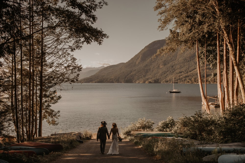 Golden Hour bride and groom walking to water boat in the water Sunshine Coast