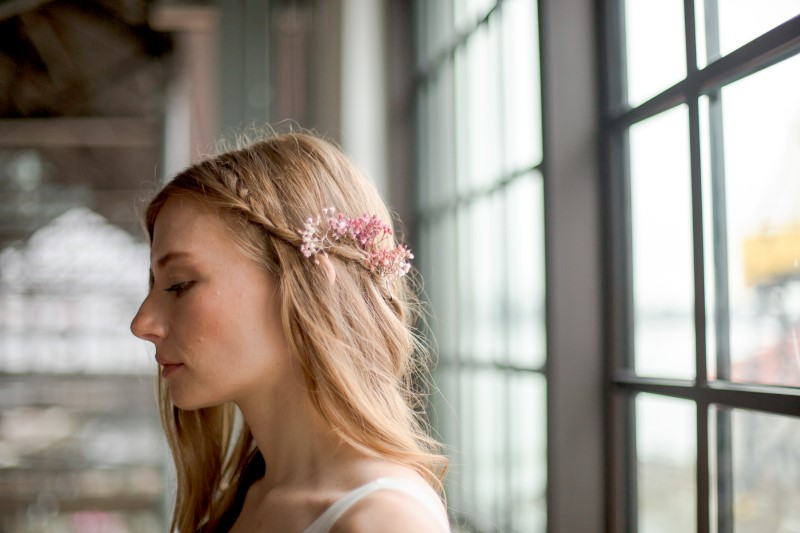 Bridal hair with braid and pink flowers by Danielle Wong Photography