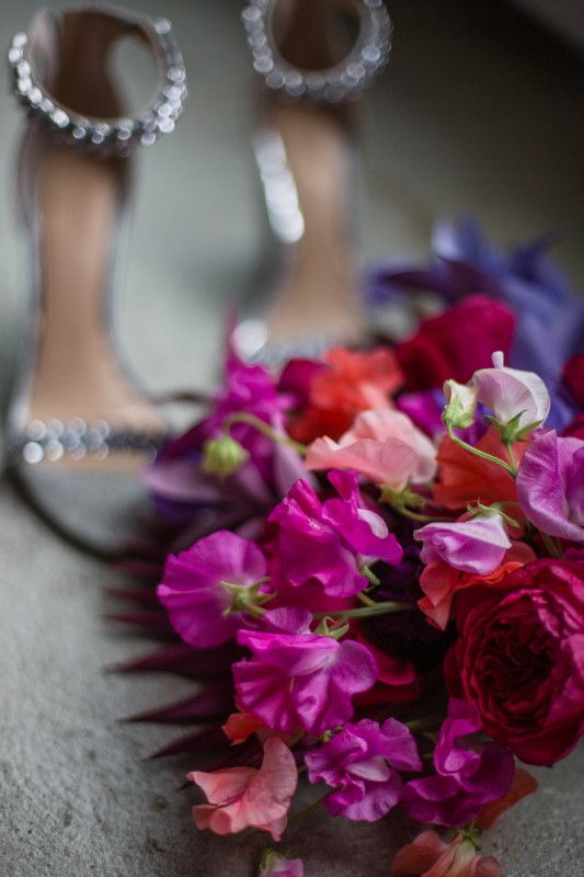 Purple, pink and white bridal bouquet with silver sparkly shoes