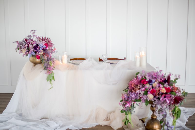 Wedding Head Table at The Wallace covered in white with pink and purple flowers