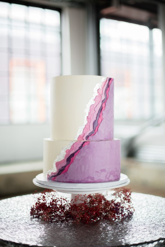 Purple and white Wedding Cake in front of windows by Taffete Designs Vancouver