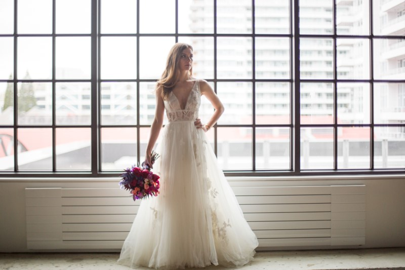 Bride in front of window in Willowbyby Watters gown