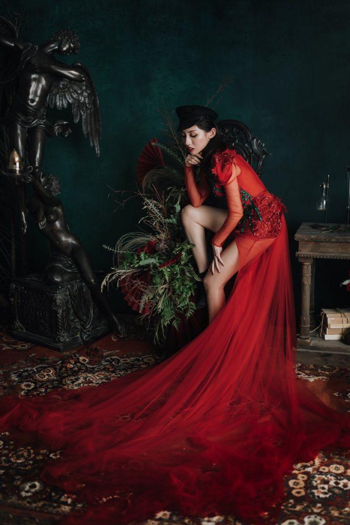 Culture Fusion bride sitting in red dress Jumi Studio