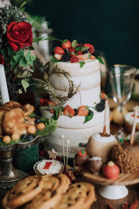 Culture Fusion naked two tiered cake with strawberry garnish Minus Cake Boutique