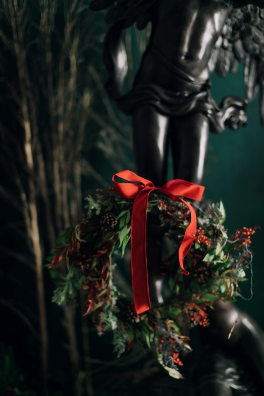 Cuture fusion angel statue, wreath with red bow