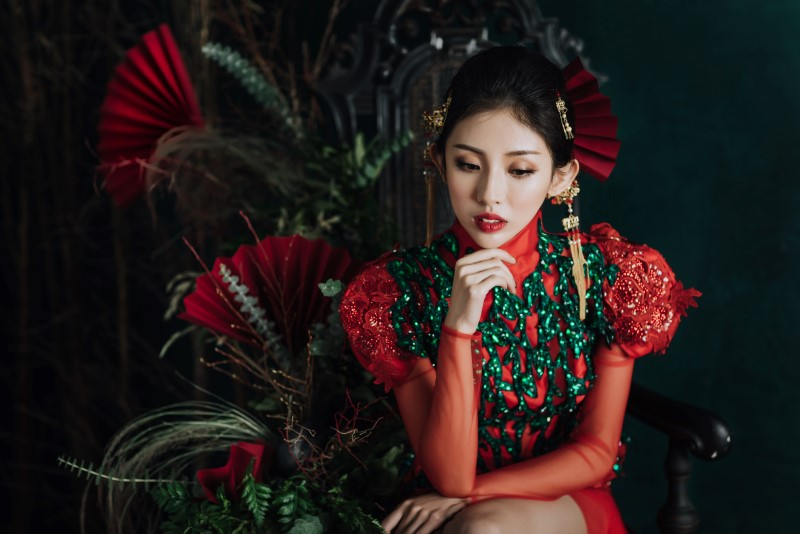 Culture Fusion bride thinking in red and green gown with red fans Silvia Makeup & Hair Vancouver